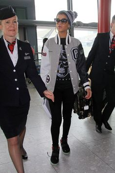 Rihanna glided through London's Heathrow Airport