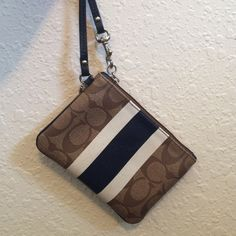 Coach Wristlet Super cute Coach Wristlet. Looks like brand new. White and navy blue stripes on the front. Coach pattern in front and back. Looks like brand new! Coach Bags Clutches & Wristlets