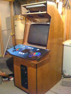 DIY MAME CABINET --> http://www.instructables.com/id/My-MAME-Cabinet/