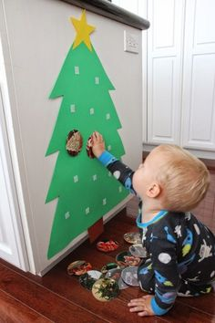 a Photo Christmas Tree for Babies & Toddlers Toddler Approved!: Build a Photo Christmas Tree for Babies & ToddlersToddler Approved!: Build a Photo Christmas Tree for Babies & Toddlers Photo Christmas Tree, Christmas Tree Crafts, Preschool Christmas, Noel Christmas, Holiday Crafts, Holiday Fun, Outdoor Christmas, Christmas Tree For Toddlers, Christmas Crafts For Kids To Make Toddlers