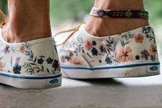 Using iron on transfers to decorate shoes.