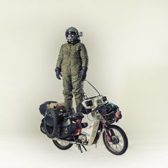 More Honda Cub nuttiness. It's a meme... this guy just got back from riding to the Arctic on his Honda c90.