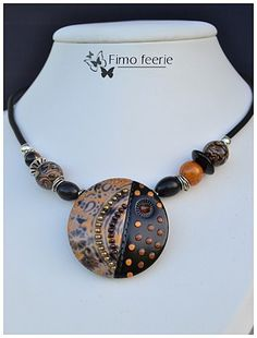 Love this piece by Fimo Feerie...with seed beads and a crystal....she calls it autumn colors..