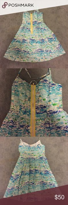 Lilly Pulitzer Blue Seascape Dress Size 0 Blue Lilly dress. Fit + flare with spaghetti straps and zip up detail in the front. So cute and flattering on! Worn once. Lilly Pulitzer Dresses