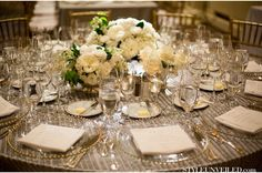 Low centerpieces and accent decor make for a nice, full tablescape