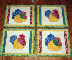 Chicken Place mats....I made this set for my sister-in-low for Christmas 2012 and beside this set was table runner. The chicken applique patter from FatCat Patterns.