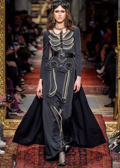 """Inspired by Tom Wolfe's 1987 novel """"Bonfire of Vanities,"""" Jeremy Scott delivered a Fall/Winter 2016 collection that reminded us of an ancient but decrepit manor house."""