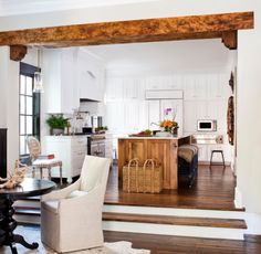 Gorgeous #cottage inspired dining room and #kitchen with large hand-hewn beams