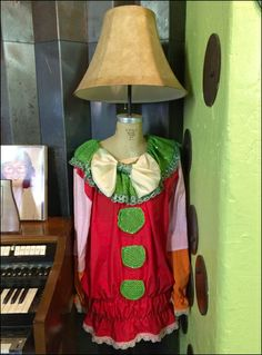 This mannequin in Pagliacci costume even came equipped with its own stage lighting. It is literally self contained Visual Merchandising. Christmas Themes, Grinch Christmas, Retail Fixtures, Stage Lighting, Dress Form, Visual Merchandising, Trading Places, Cosplay, Costumes