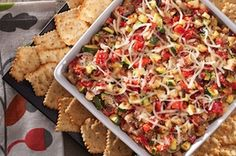 Rustic tastes elevate your open house with Holiday Italian Veggie & Cheese Dip. Serve with WHEAT THINS Toasted Chips.