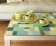 Can't find a table you like? Customize one using an inexpensive, white, IKEA table, paint chip samples in your choice of color scheme, and add a piece of glass on top.