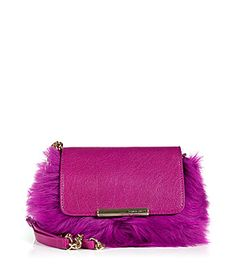 Statement-making in bright azalea fur and leather, this petite clutch from Emilio Pucci adds eye-catching polish to day and evening looks alike #Stylebop