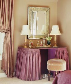 Outfitted with a mulberry-colored table skirt and a gilt-accented mirror, this vanity is perfectly feminine. - Traditional Home ® / Photo: Jeff McNamara / Design: Karen Miller Mirrored Vanity Table, Vanity Table Set, Dressing Table Vanity, Vanity Decor, Dressing Tables, Vanity Stool, Vanity Ideas, Dressing Room Closet, Dressing Rooms