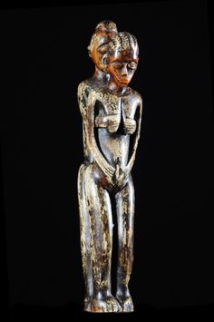 old piece ivory  Bateba statuettes are ritually used when a man has trouble finding a mate, or to solve problems of impotence or fertility. The Healer then prescribed the realization of such a statue to be placed on an altar.