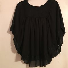 Black flowy baby doll top Top lace part is a little tight. I wouldn't recommend for bigger chested and need to wear and undershirt cause it is see through. Love this top. So flattering. Tagged for visibility Urban Outfitters Tops Blouses