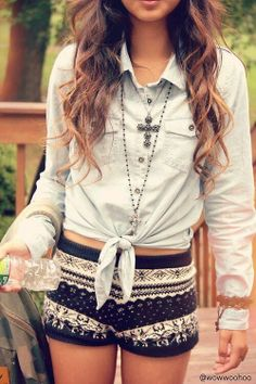 Denim white washed shirt with patterned shorts and jewelry.