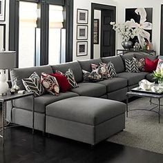 U-Shaped  gray sectional with red accent pillows