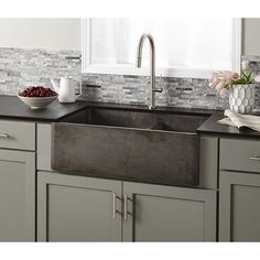 Kitchen Sink Remodel x Double Basin Farmhouse Kitchen Sink - This concrete farmhouse sink not only looks good, but is hard-working, with two deep bowls and simple maintenance. And versatile to boot. Install as apron front or behind the counter. Apron Front Kitchen Sink, Farmhouse Sink Kitchen, Kitchen Redo, New Kitchen, Kitchen Cabinets, Kitchen Ideas, Modern Farmhouse, Double Farmhouse Sink, Green Cabinets