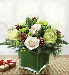 Shop Christmas flowers & gifts for delivery to celebrate the season! Find beautiful Christmas floral arrangements and holiday flowers. Winter Flower Arrangements, Rosen Arrangements, Christmas Arrangements, Christmas Table Decorations, Floral Arrangements, Christmas Tables, Christmas Flowers, Winter Flowers, Christmas Wreaths