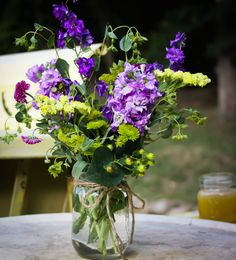 Perfect purple buds feeling fresh from the garden! We love this flower style for our rustic garden and farm inspired weddings! A little whimsy makes a whole lots of wonderful! #cedarwoodweddings Tennessee Rustic Vintage Wedding | Cedarwood Weddings
