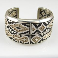 Cuff | Dan Jackson (Navajo). 'Navajo Rug'.  Sterling silver with patina.