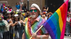 Rainbow flag creator Gilbert Baker marches during the 2015 San Francisco Pride Parade. Baker says he wept when the Supreme Court announced its decision making same-sex marriage legal nationwide.
