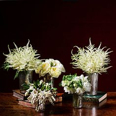 Holiday Flower Arrangement | We love the idea of decorating with dazzling winter white for the holiday season! Learn how to make these bouquets step-by-step.