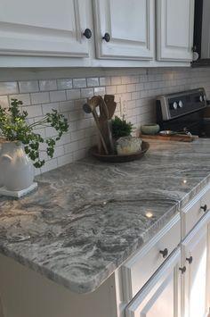 White Cabinets With Grey/Black Granite