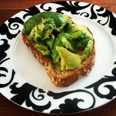 delicious simplicity: avocado on whole wheat toast with a drizzle of olive oil and a sprinkle of salt and pepper