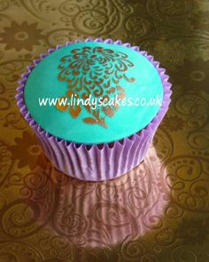 Stylised flower stencilled cupcake by Lindy Smith by Lindy's cakes, via Flickr