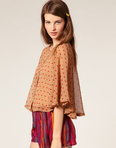 Layered over a nursing tank, this floaty cape blouse will provide artistic coverage.