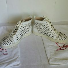 "Christian Louboutin Flat CALF SPIKES White Unisex Christian Louboutin Spikey silver studs sneakers in white Calf skin Leather. In great condition and well taken care of. Worn only few times! Euro Size 39.5 which is approximately converted to US Mens Size 7.5""  and US Women size 8.5. This is also equivalent to UK6.5 for womens and Mens UK size 7. Christian Louboutin Shoes"