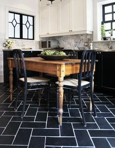 This is gorgeous! I've been enjoying the two-toned kitchens with black or grey lower cabinets and white on top. The black window details really pull it all together in this kitchen! Amazing! I'm not sure if something this bold would work in the tiny kitchens we've been seeing, but I do love, love, love it.