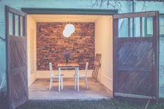 Old garage turned into a cosy outdoor dining area.