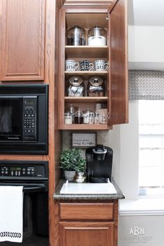 Make your own coffee cabinet with these coffee cabinet organization tips and free printables. Includes a full shopping list of items you will need! Coffee Cabinet Organization Tips + Free Printables Coffee Bar Station, Coffee Station Kitchen, Coffee Bars In Kitchen, Coffee Bar Home, Home Coffee Stations, Keurig Station, Drink Stations, Bar Kitchen, Kitchen Ideas