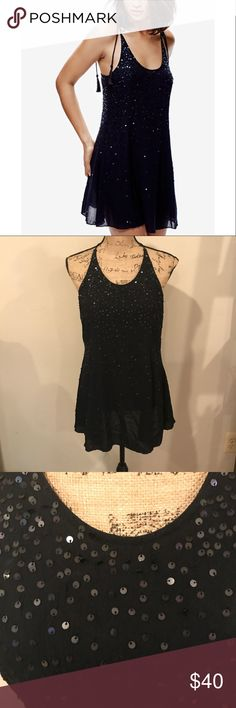 Free People Embellished Sequin Slip Dress NWT, never worn! Style: Just Watch Me Slip Dress. So pretty slip featuring shimmering sequin accents sprinkled throughout.  Crossed back design with cute tasseled ties Lightweight, semi-sheer fabrication Free People Dresses Mini