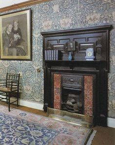 """William Morris fireplace -- once I was so distracted by the """"William Morris"""" room in a period movie that I missed all of the dialogue, but I can tell you about the willow wallpaper and wonderful fireplace.  I wonder where this room is located..."""