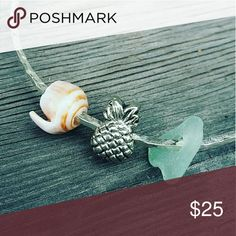 SS .925 pineapple bangle Starling silver bangle adorned with a pineapple charm , puka shell and genuine surf tumbled seaglass  Hand size : 8 inches  Closed bangle and hammered for texture ocean drift jewelry hawaii Jewelry