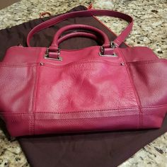 Hot Pink Leather Tignanello Purse Like new! Has satchel handles and shoulder handle. Nice silver hardware. Tignanello Bags Shoulder Bags