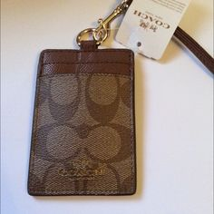 Coach Signature PVC Lanyard IM/Khaki/Saddle NWT Authentic Coach Signature PVC Lanyard IM/Khaki/Saddle, 2 card slots, ID window, removable strap.  New With Tags, Gift Box Included. No Trades No Holds Coach Accessories