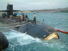 USS San Francisco in Apra Harbor, Guam, Jan. 12, 2005, after colliding with undersea mount. Frank Cable in background.