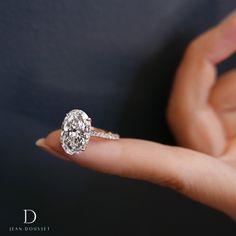 CHELSEA is a handcrafted Jean Dousset Diamonds solitaire engagement ring set in Platinum with three rows of diamonds on the band - JeanDousset.com - pictured with an Oval Cut diamond.#engagementring