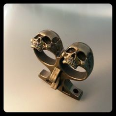 skull buster knuckle duster bottle opener by KickassPlugs on Etsy