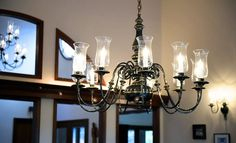 Light fixture in dining room: Electric candelabra with glass holders.