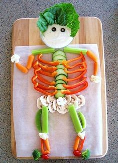 This veggie-man's head is a bowl of ranch dressing! Studies have found that children eat more veggies (especially broccoli and carrots) when they are paired with ranch. You can also try hummus!
