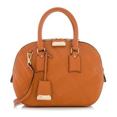 Inspired by vintage English luggage, this classic Burberry satchel is made from Check embossed grained leather in the Copper Orange color with gold-tone hardware. Details include two rolled handles, a double-zip closure, and fully lined interior with two open pockets and one zippered pocket. Carry this style on the forearm or over the shoulder with a detachable strap.