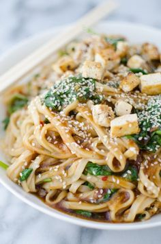 Vegan Fresh ginger-sesame sauce stir-fried with udon noodles, quick fried tofu and spinach!