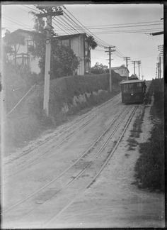 View of a tram descending the hill, coming towards the camera, in Staurt Street, Dunedin. Photograph taken by Albert Percy Godber in Informa. Long Gone, My Big Love, Historical Photos, Kiwi, Old Photos, New Zealand, Cable, Memories, History