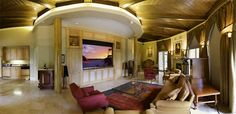 Hidden Home Theater: Located in the heart of this Deltec home, Harmony Interiors brilliantly designed a home theater in an open circular room.