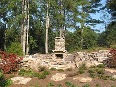 Rustic outdoor fireplace built by Unique Outdoor Concepts